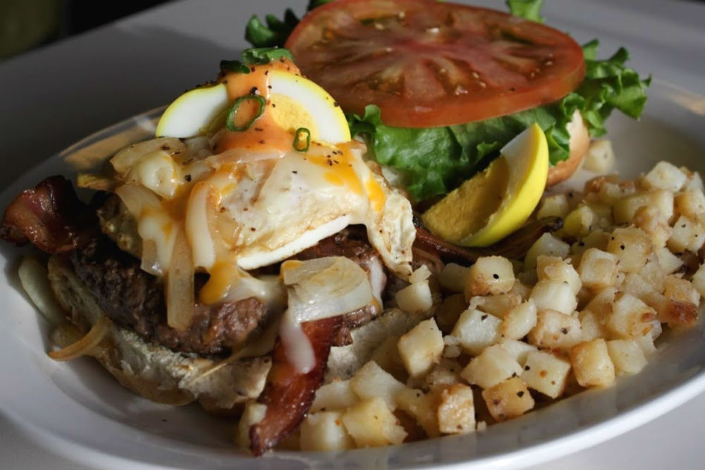 breakfast with potato's and tomatos as ingredients in belmont diner